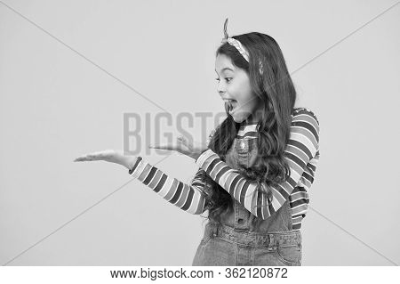 Girl Demonstrate Product. Promoting Product For Kids. Launching Product. Advertisement Concept. Prod