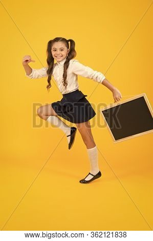 Starting School With A Smile. Happy Small Child Going To School On Yellow Background. Active Little