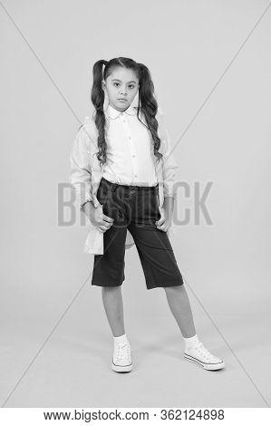 Happy Schoolgirl Wear Raincoat On Yellow Background. Small Schoolgirl Wear Water Resistant Clothes F