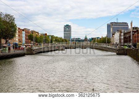 Dublin, Ireland - July 1, 2019: Hapenny Bridge In Dublin, Famous Tourist Attraction. Half Penny Over