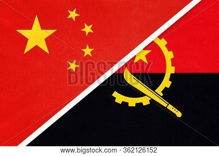 China Or Prc Vs Angola National Flag From Textile. Relationship Between Asian And African Countries.