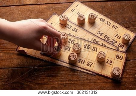 Family Vintage Interesting Lotto Bingo Game, Hand Holds A Keg With A Number