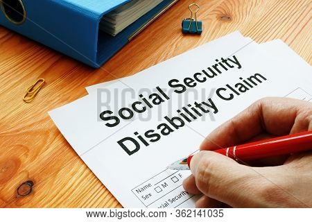 Man Filling In Social Security Disability Claim.