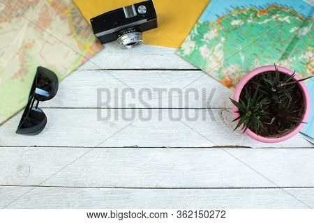 The Concept Of Travel And Recreation. Amera, Maps Geographic, Passport, Money, Bag, Glasses, Sunscre