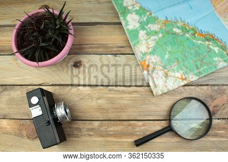 Travel Concept On Wooden Table. Top View Image Of Travel Accessories With Washed Out Vintage Filter