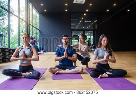 Fitness, Stretching Practice, Yoga Teacher With Group Students Working Out In Sports Club, Instructo