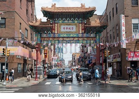 Chinatown Friendship Gate and passersby in Philadelphia, Pennsylvania, USA on July 6, 2019.
