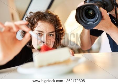 Photo assistant or food stylist at the photo shoot for food advertising