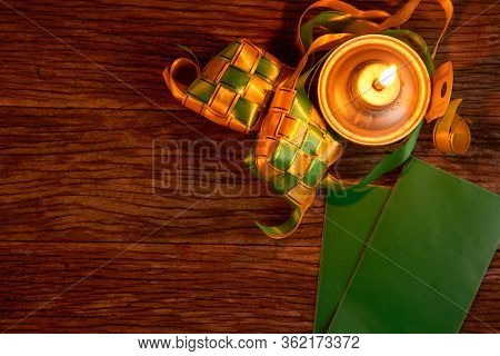 top view of oil lamp and decoration dumpling-ketuat