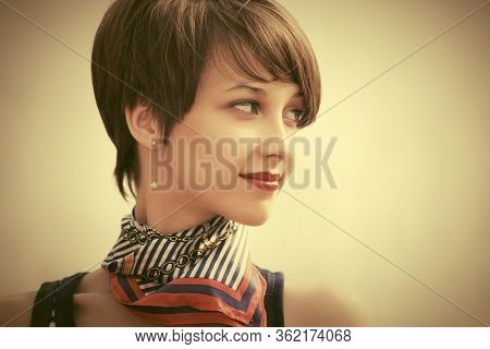 Happy young fashion woman with pixie hair style Stylish female model in striped tank top and silk scarf
