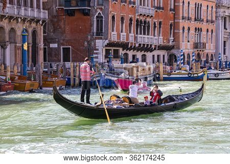 Venice, Italy - September 28, 2015 : Water Channels Of Venice City. Gondolier Rolls Tourists On The