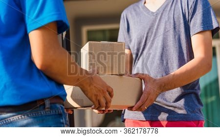 Asian Young Delivery Man Courier With Package Post Box In Uniform He Protective Face Mask He Making