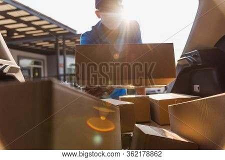 Asian Delivery Man Courier Moving Deliveries Out Boxes In Back Car He Protective Face Mask, Service