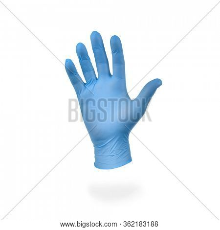 Hand in blue medical glove isolated on white background.