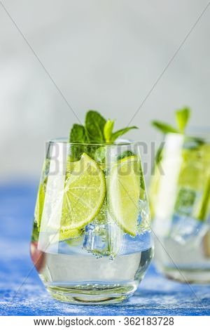 Two Detox Water Or Mojito Close Up. Summer Bright Drinks With Mint. Refreshing Drinks And Juices Fro