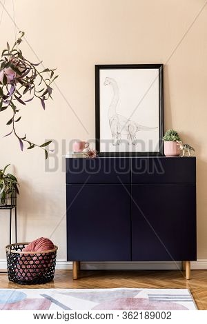Stylish Interior Of Living Room With Black Mock Up Poster Frame, Plants, Blue Navy Commode, Decorati