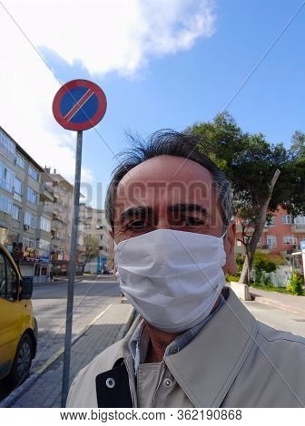 Man in city street wearing face mask protective for spreading of Coronavirus Disease. Portrait of ma