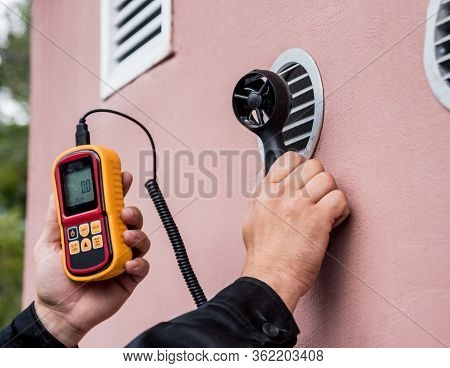 Technician Use Hand-held Anemometer Measuring Air Flowing Measurement