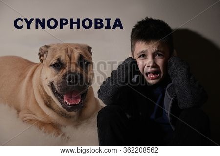 Scared Little Boy Suffering From Cynophobia On Beige Background. Irrational Fear Of Dogs
