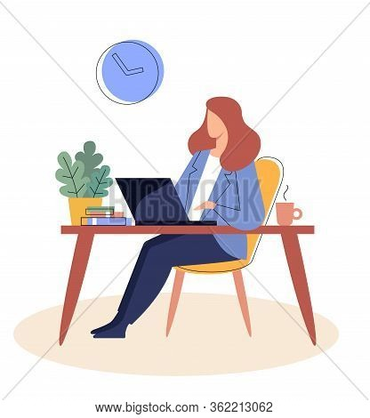 Businesswoman Is Sitting At A Table With A Laptopr.