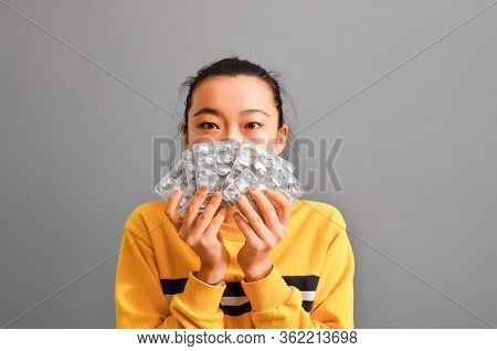 Asian Young Woman With Pharmaceuticals Antibiotics Pills Medicine. Colorful Antibacterials Pills On