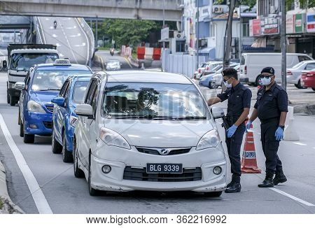 Malaysia Soldier And Police Inspect Road Users To Prevent Spread Of Coronavirus Disease 2019 (covid-