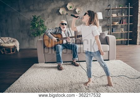 Photo Of Grandpa Sit Sofa Play Guitar Little Pretty Granddaughter Hold Mic Singing Song Spend Time T