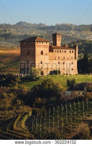Sunset In Autumn, During Harvest Time, At The Castle Of Grinzane Cavour, Surrounded By The Vineyards