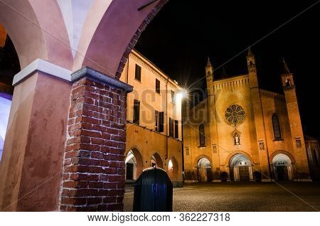 Piazza Risorgimento, Main Square Of Alba (piedmont, Italy) At Night, With The Facade Of Saint Lawren