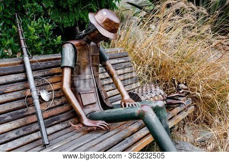 Turin, Italy - December 11, 2016: Urban Sculpture, Made By Rodolfo Marasciuolo, Of A Fisherman With