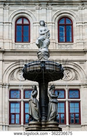 Vienna Opera House (wiener Staatsoper) In Austria, Detail Of The Facade And Of The Fountains Outside