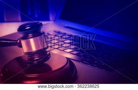 Legal law concept image, gavel on computer