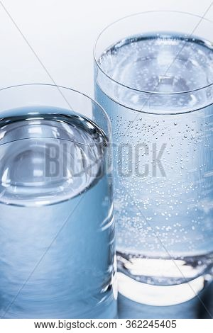 Close-up Of Glasses With Mineral And Tonic Water On A Blue Table. Mineral Water And Tonic Water Glas
