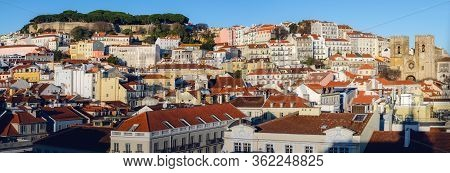 Sunset Panorama Of Alfama Neighborhood In Lisbon, Portugal, With The Famous Castle Of Sao Jorge On T