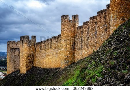 Outside Stone Walls Of The Convent Of Christ, Ancient Templar Stronghold And Monastery In Tomar, Por