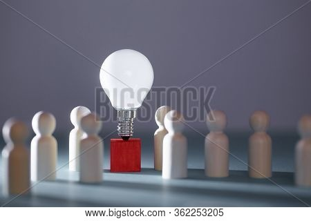 Wooden Figures, Lightbulb On Red Cube. Team Creativity, Idea Mockup. Creative Approach And Lateral T
