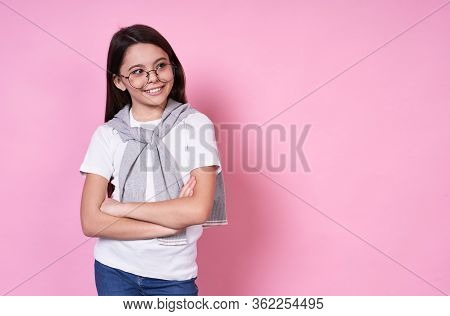 Sympathetic Emotional Cute Caucasian Long-haired Brunette Girl Wearing Glasses With Her Arms Crossed