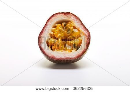 Passiflora Fruit Half Isolated On A White Background.