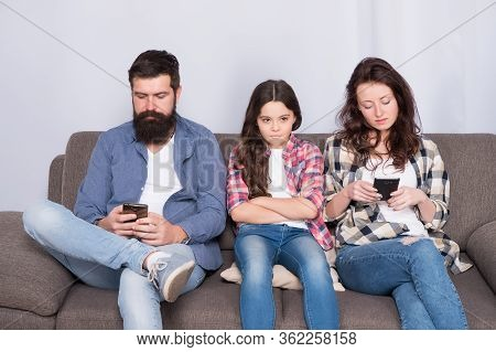 Ignored Child. Busy Parents Surfing Internet Smartphones. Dad And Mom Ignoring Daughter Needs. Bad H