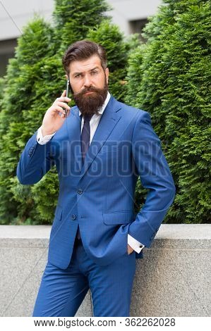 Stay Connected. Businessman Talk Mobile Phone. Handsome Man With Cell Phone Outdoor. Phone For Profe