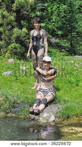 Two Girls In The Therapeutic Mud