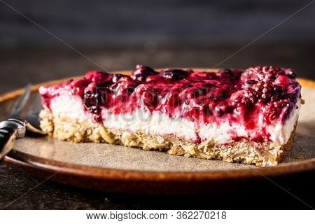 Sweet berry cake. Pie with blueberries and raspberries on plate.