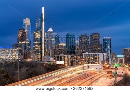 Cityscape of Philadelphia skyscraper Skylines building twilight dusk sunset with highway urban road transportation in Philly city downtown of Philadelphia in PA USA. Cityscape Urban lifstyle concept.