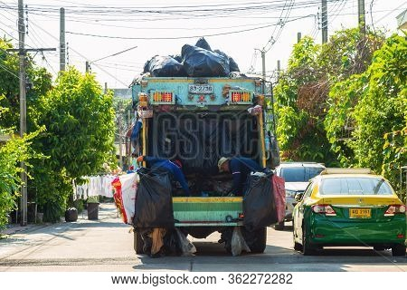 Nonthaburi, Thailand- April 21, 2020 : Local Garbage Collector Is  Collecting Garbage Into The Garba