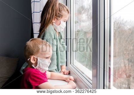 Cute Children Boy And Girl In Medical Mask Stay Home On Quarantine. Children Play Home. Entertainmen