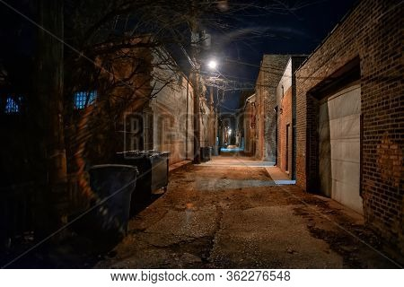 Dark and eerie urban city alley at night