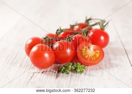 red cherry tomato and parsley