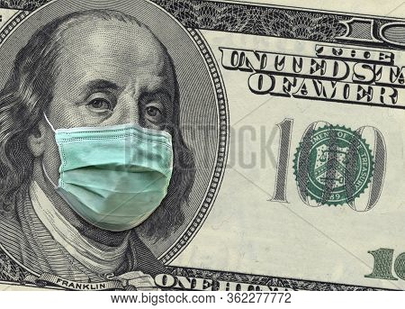A Close Up Of A 100 Dollar Bill Shows Benjamin Franklin Wearing A Surgical Mask To Protect Himself F