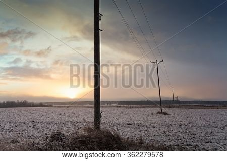 The Winter Sun Rises Over The Snowy Fields Of The Northern Finland. The Morning Is Cold But Beautifu