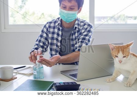 Business People Work From Home Wear Masks And Use Alcohol Sanitizer To Prevent The Spread Of The Cov
